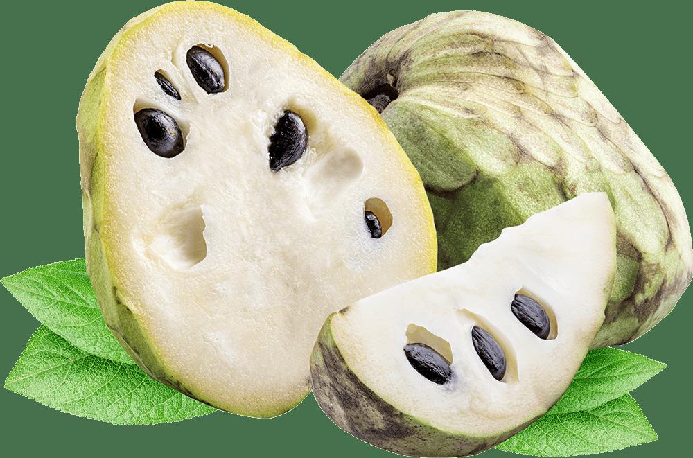 Cherimoya fruit cut in half showing seeds