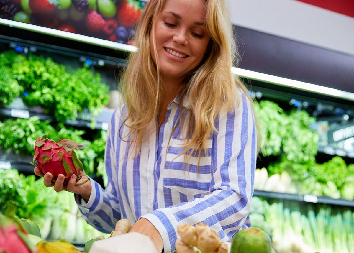 Woman picking fruit in the supermarket.