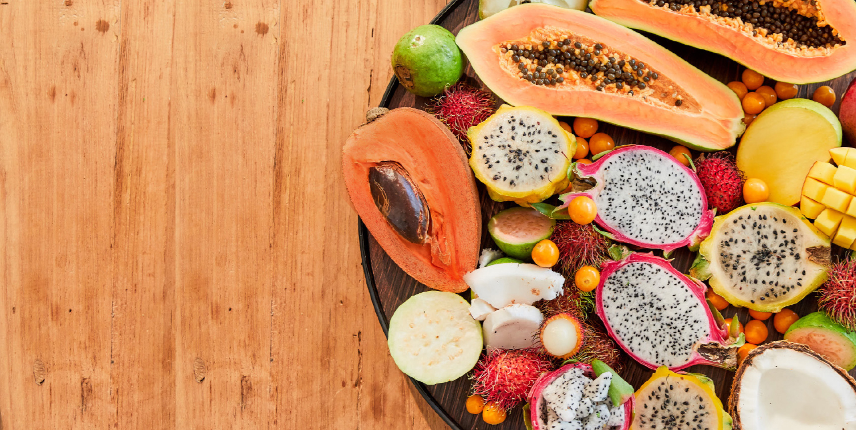 Tropical fruit platter with papaya, dragon fruit, golden berries, mamey.